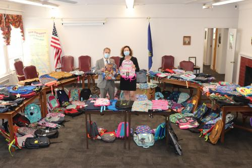 Commissioner Frank Edelblut and organizer Diana Fenton wrap up the DOE's 5th Annual Backpack Drive.